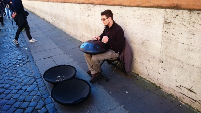 Alessio playing the Hang drum on the streets of Vatican City. (Image by D. Blake)